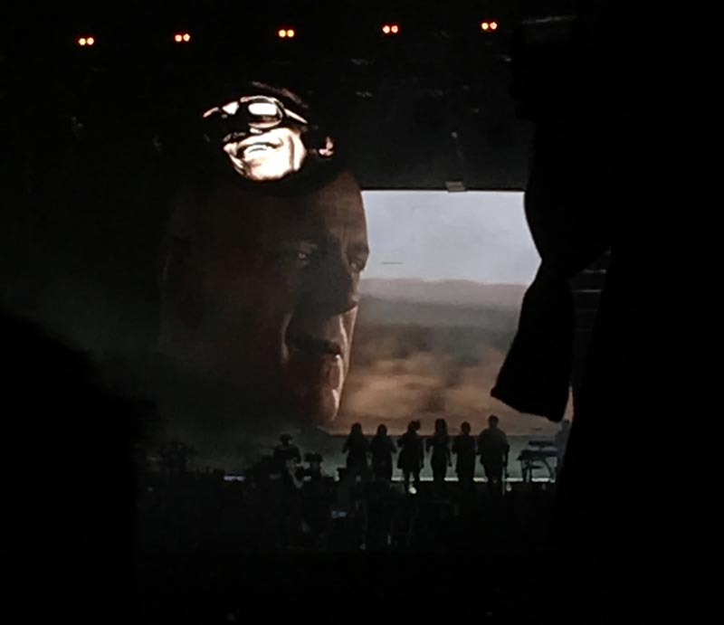"""A scene from the music video for """"Stylo,"""" projected on the screen behind the band. Photos and video by Shayna Tanen."""