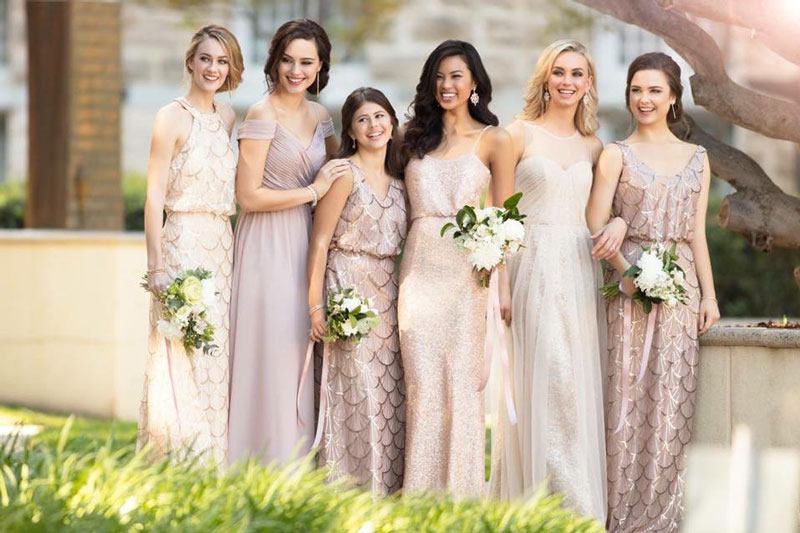 Neutral dresses in mix-and-match colors and patters. Courtesy of Wonderland Bridal Couture.