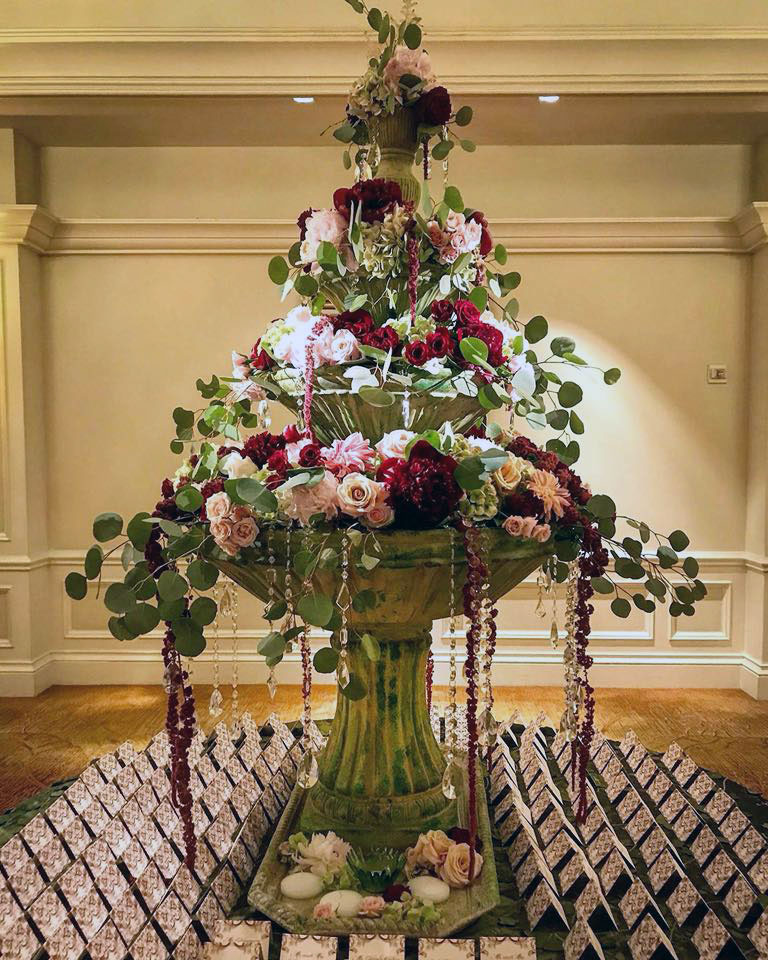 A cascading flower arrangement by JM Event Productions. Courtesy of JM Event Productions.
