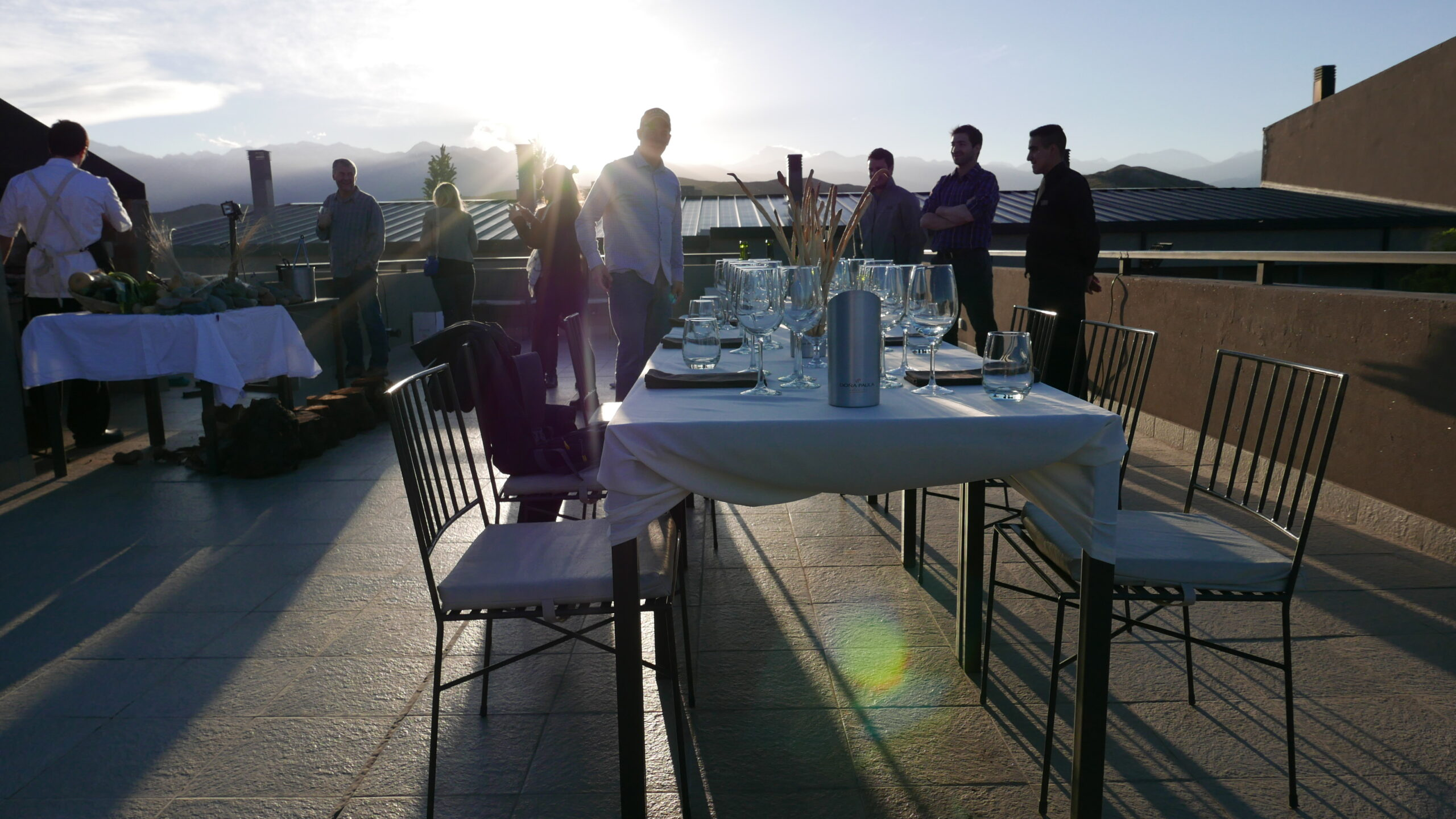 As the sun sets behind the Andes, the Auberge du Vin, A Tribute Portfolio Hotel, sets up a rooftop wine tasting.